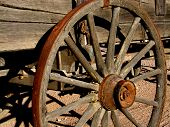 picture of superstition mountains  - old western wagon with rusted wheel near superstition mountain - JPG