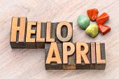 Hello April in vintage letterpress wood type with green and red gemstone crystals poster