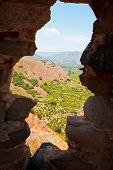 foto of calatabiano  - view on lands through loophole in old Arab - JPG