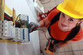 foto of fuse-box  - Female electrician checking fuse box - JPG