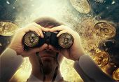 Businessman with binoculars looking to the future. Bitcoin cryptocurrency poster