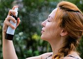 A Girl With A Spray Bottle In Her Hands, Sprays Water On Her Face. Natural Cosmetics, Handmade For R poster