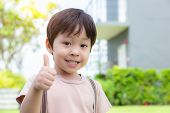 Cute Little Boy Showing Thumb Up With Smiley Face. Lovely Boy Feel Happy And Relaxed. He Has Good He poster