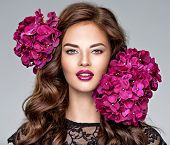 Beautiful woman with bright purple makeup.  Young caucasian gorgeous adult girl with long brown curl poster