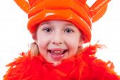 foto of blown-up  - Girl with big blown up orange crown for Dutch soccer game or Queens day in closeup over white background - JPG
