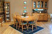 foto of curio  - Country style dining room has oval oak table and six chairs - JPG