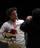 KIEV, UKRAINE - APRIL 14, 2012: Member of Hungarian team Gabor Boczko with his epee before the fight