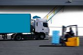 stock photo of supply chain  - blue and white semi truck on warehouse parck - JPG