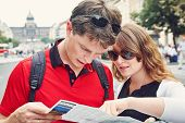 Young Couple In Love Walking On A Street Of European City. Sightseeing Traveler With Map poster