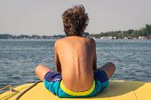 Traveler Boy Relaxing On Boat Floating On River. Young Boy Relaxing In Vacation. Boy Relaxing On Riv poster