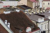 Roofs Of Old Houses. The Roofs Of The Old House. In Romania. View Of The Roofs Of The Old Town In Th poster