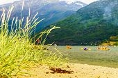 Holidays And Active Lifestyle Concept. People Kayaking On Fjord Aurlandsfjord In Norwegian Tourist D poster