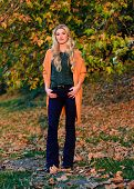 Cozy Outfit Ideas For Weekend. Girl Adorable Blonde Posing In Warm And Cozy Outfit Autumn Nature Bac poster