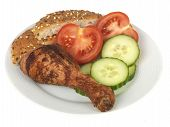 stock photo of bap  - cold roasted chicken drumstick leg salad tomatoes cucumber bap plate isolated white background - JPG