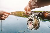 Coil Of Fly Fishing Rope, Man Hands Holding Rod poster