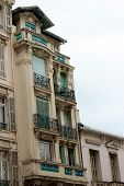 Old European Architectural Building Corner With Balconies And Penthouse In France poster