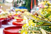 Closeup And Crops Heap Of Fragrant Flowers With Incense On Red Wooden Trays For Worship The Buddha I poster