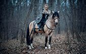 Viking Warrior Female Ridding A Horse At Twilight Autumn Forest - Medieval Movie Scene poster
