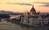 Cityscape Of Budapest With Bright Parliament And Danube River With Bridge. Pink And Purple Colors Of poster