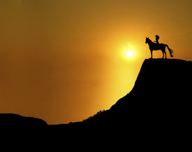 stock photo of horse girl  - illustration of woman and horse on mountain ridge at sunset - JPG