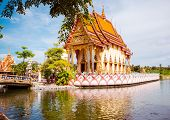 foto of sanctification  - A beatiful Buddhist temple in Thailand in a little isle in the middle of a lake - JPG