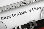 Curriculum vitae written on an old typewriter concept for job search