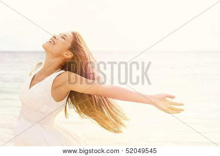 Freedom woman in free happiness bliss on beach. Smiling happy multicultural female model in white su poster