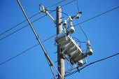image of utility pole  - Modern technology in transformer and relay design makes for a neater looking utility pole.
