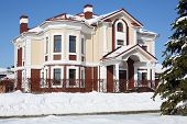 image of peace-pipe  - Big cottage with red roof and white drain at frosty and sunny winter day - JPG