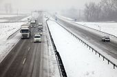 stock photo of icy road  - Highway traffic in heavy snowfall - JPG