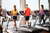pic of treadmill  - Group of people running on treadmills - JPG