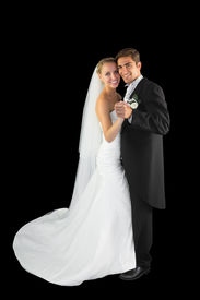 foto of waltzing  - Happy young married couple dancing viennese waltz smiling at camera - JPG