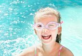 Pretty Smiling Little Girl In Swimming Pool