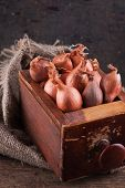 Shallots onion In An Old Wooden Box