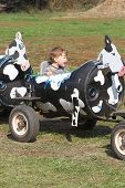 stock photo of hayride  - Child having fun on a farm ride - JPG
