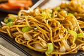stock photo of lo mein  - Asian Chow Mein Noodles with Vegetables and Chopsticks - JPG