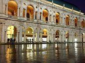 stock photo of palladium  - beautiful Palladian Basilica in Piazza dei Signori in Vicenza in Italy at night 1 - JPG