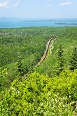 Freight train moving through forest of northern Ontario near Lake Superior in Canada