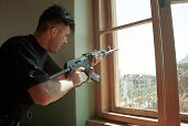 MOSTAR, BOSNIA - AUGUST 17: A Bosnian Croat soldier shoots out of a window at Bosnian Muslims defend