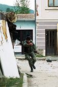 GORNJI VAKUF, BOSNIA - AUG 21: A Bosnian Muslim soldier runs for cover during fierce fighting with C