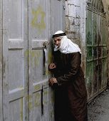 HEBRON - JANUARY 7: An Arab shop owner closes up for the day in the contested city's souk bazaar in