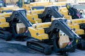 Brand New Excavators On The Shipping Dock poster