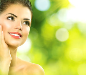 stock photo of cosmetic products  - Beauty Spa Woman over nature green background - JPG