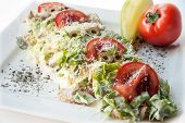stock photo of shredded cheese  - A Caesar Salad with shredded parmesan cheese croutons and tomatos - JPG
