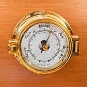 stock photo of barometer  - Yacht Barometer Close Up shot on wooden background - JPG