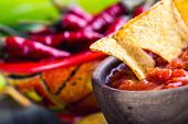 picture of doritos  - Salsa with tortilla chips and chilli peppers - JPG