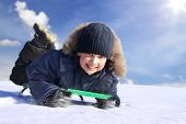 pic of toboggan  -  happy boy on sled - JPG