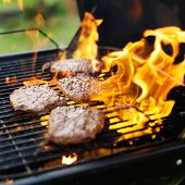 pic of braai  - hamburgers being grilled with flames - JPG