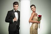 image of evening gown  - happy young married couple posing near column - JPG