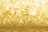 image of glitter sparkle  - Gold Defocused Glitter Background With Copy Space - JPG